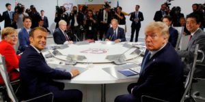 US President Donald Trump and French President Emmanuel Macron with other heads of state at the recent G7 Summit in France.